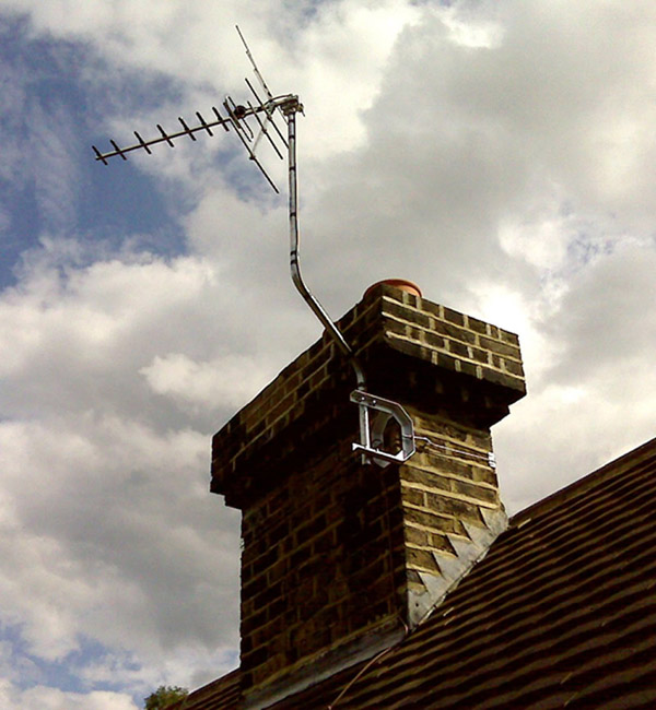 TV aerial fitted on a chimney stack